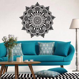 Vinilos de pared con mandala byn y sofá azul